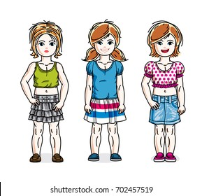 Cute little girls standing in stylish casual clothes. kids illustrations set.