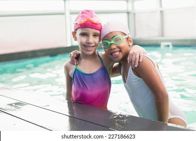 Cute little girls in the swimming pool at the leisure center