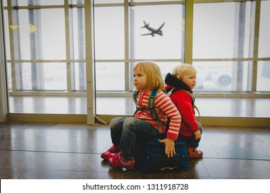 cute little girls waiting in airport, family travel