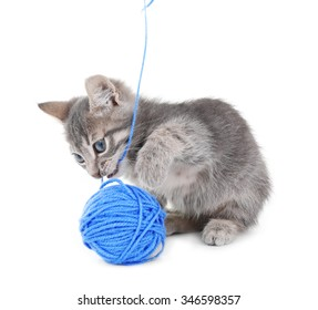 Cute little grey kitten with skein of thread, isolated on white