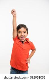 cute little indian boy showing attitude