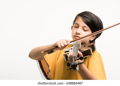 Cute little Indian/asian girl playing violin, isolated over white background