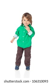 Cute little kid, 2 years old boy, standing and looking at camera, wearing shirt and jeans. High resolution image isolated on white background with copy space. Studio shot.