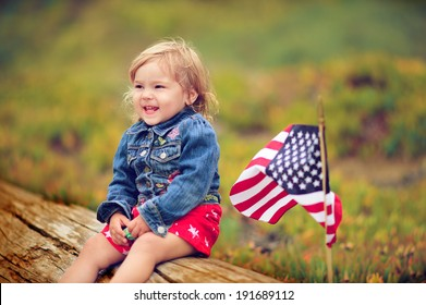 cute little kid celebrate independence day 4th july with an american flag