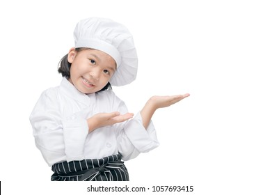cute little kid chef showing and presenting. child chef isolated on white background.