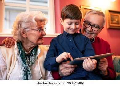 Cute little kid having fun with a present from his loving grandparents