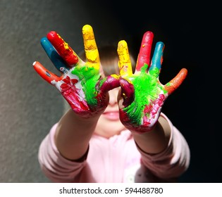Cute little kid with painted hand