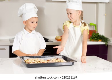 Cute Little Kids Bake Something to Eat at the Kitchen