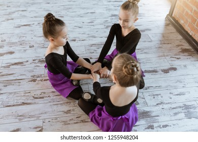 Cute little kids dancers on dance studio. Choreographed dance by a group of small ballerinas practicing at a modern ballet school
