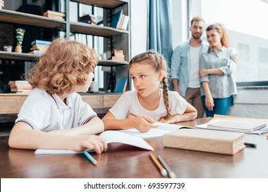 cute little kids doing homework together