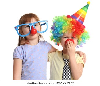 Cute little kids in funny disguise on white background. April fool's day celebration