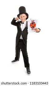 Cute little magician with cards on white background