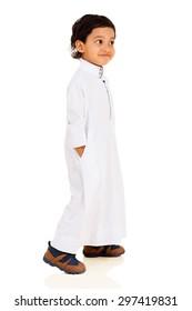 cute little Muslim boy walking on white background
