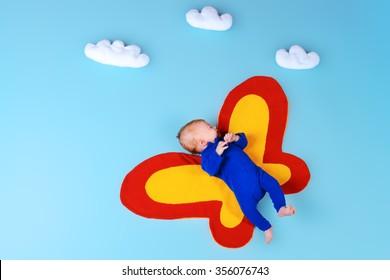Cute little newborn baby in a suit of butterfly.