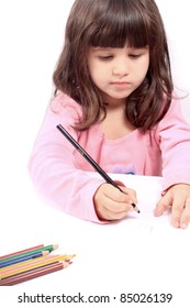 Cute little preschool girl  drawing with pencils on white