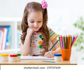Cute little preschooler child drawing at home - Shutterstock ID 279747659