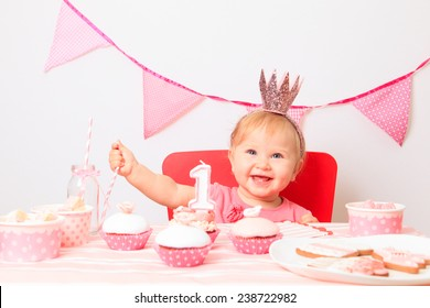 cute little princess at first birthday party