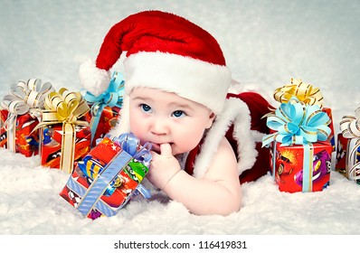 Cute little santa baby with New year??s  gifts