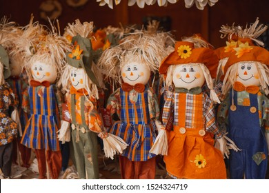Cute little scarecrow ( straw man ) handmade toys for decoration or play. Autumn festival, Thanksgiving, Halloween, Selective focus.