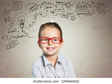 Cute little schoolgirl in glasses on  background