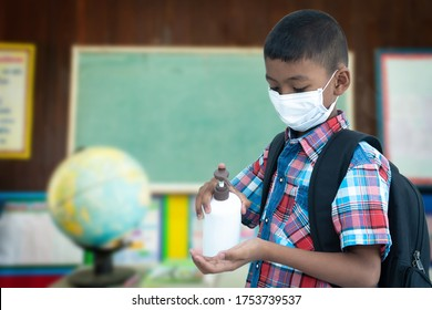 Cute little student boy hold sanitizer hand for wash hand at the school