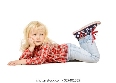 Cute little three year old girl lying on a floor and pensively looking at camera. Kid's concept, emotions. Isolated over white.