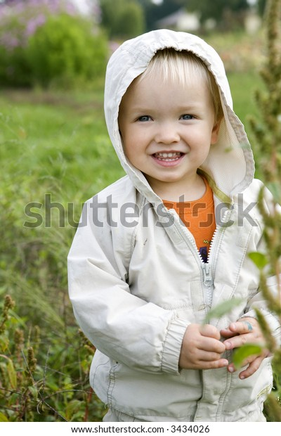 Cute little toddler with big smile on his face outdoors