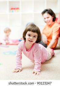 Cute little toddler girl having fun at home