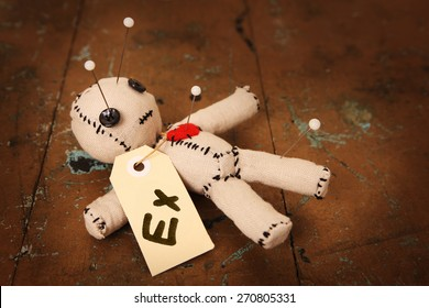 "Cute Little Voodoo Doll with ""Ex"" label"