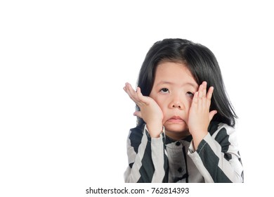 A Cute Lttle Asian Girl Make funny faces Show signs of regret on Isolate White Background.