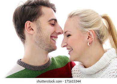 Cute man and beautiful girl are laughing