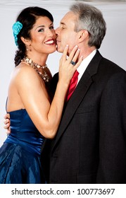Cute mature couple, in formal dress and a very romantic mood with kissing and lots of touch