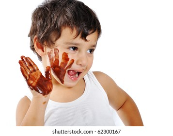 Cute messy kid isolated on white eating chocolate