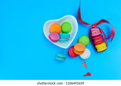 Cute mini macaroons cookie with ribbin decoration on blue backgrounds above, Flat lay