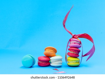 Cute mini macaroons cookie with ribbin decoration on blue backgrounds