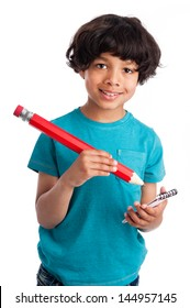 Cute mixed race boy with giant pencil isolated on white background.