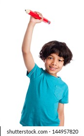 Cute mixed race boy throwing giant pencil isolated on white background.