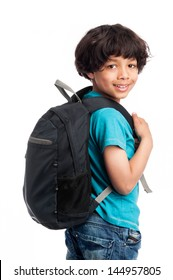 Cute mixed race boy walking away with rucksack on his back.