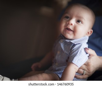 Cute Mixed Race Infant Having Fun with His Parents.