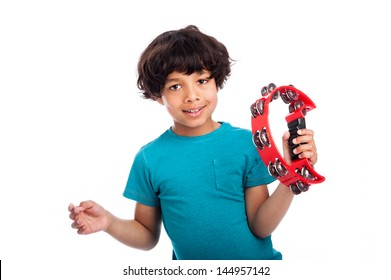 Cute mixed race kid playing a tambourine, isolated against white background.