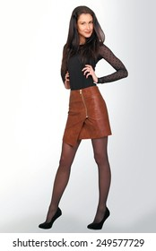 Cute model with hands on hips, girl fashion