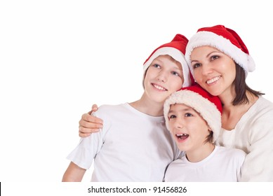 cute mom and her kids in santa hats