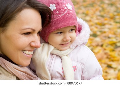cute mom with her little daughter in park