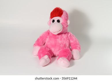 Cute monkey doll on white background