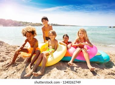 Cute multiethnic kids spending summer on the beach