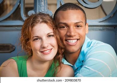 Cute Multiracial couple hugging.