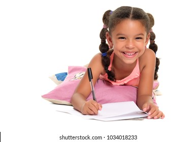 Cute multiracial laying on the floor and writing  - Isolated on a white background
