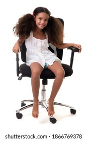 Cute multiracial small girl sitting on an office chair - Isolated on a white background