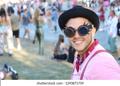 Cute music festival male attendant
