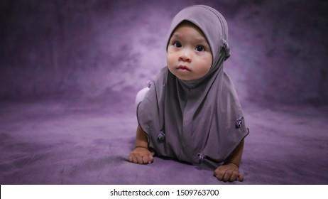 Cute muslim baby girl portrait in studio.